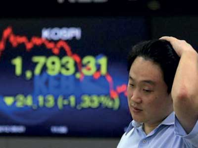 Dollar surges, Asia markets dive on Fed rates signal Image_1481807191-8dd8cf36b2